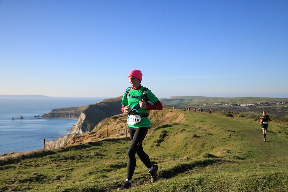 Coach Alexa running on the Dorset coast