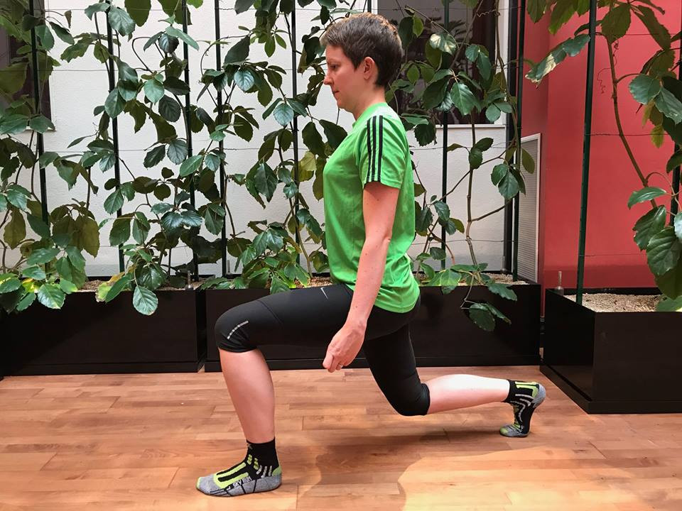Me in a green top doing a lunge
