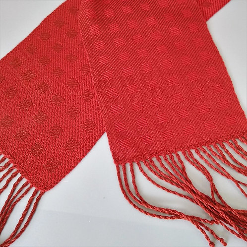 Handwoven block twill scarf in ruby and spice tencel.