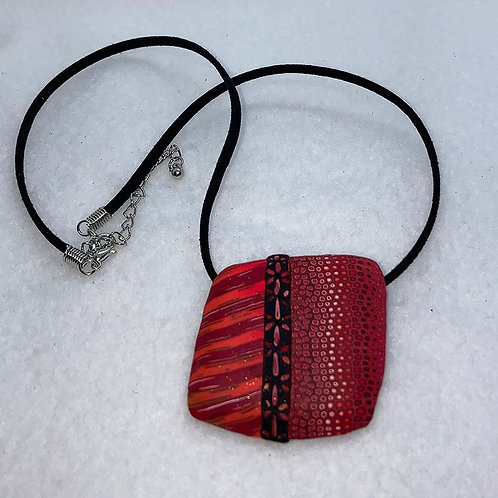 Red hot reds large caned and carved pendant, adjustable