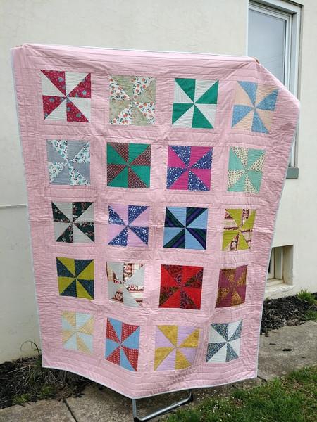 This Quilt was originally made by my client's grandmother and she used it to the point that some fabrics fully disintegrated.    We matched and updated fabrics and I reconstructed the quilttop with fresh batting, backing, and binding so it can be loved for many more years to come!
