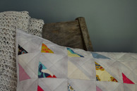 Pieces from the quilt that could not be used in the blanket were then used to make a throw pillow.