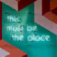 """Sign saying """"this must be the place"""""""
