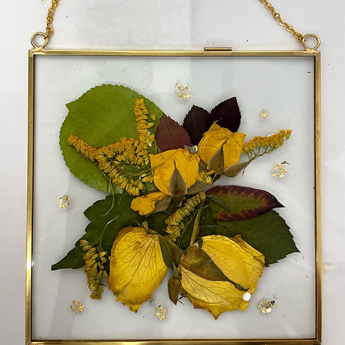 Four yellow roses and GoldenRod