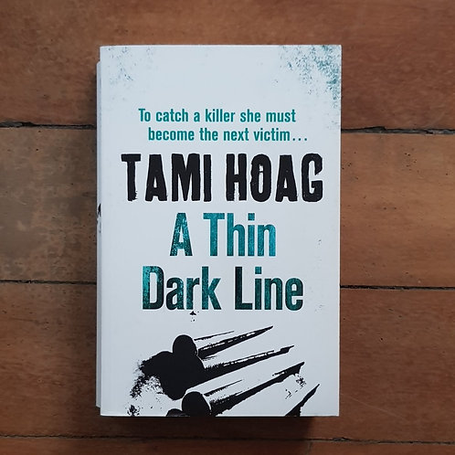 A Thin Dark Line (Broussard and Fourcade #1) by Tami Hoag (soft/good)