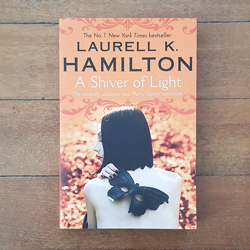 A Shiver of Light  by Laurell K. Hamilton (soft cover, v.good condition)