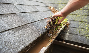 Removing dirt an grime from gutters