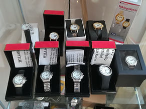 This image shows 10 talking watches, there is a mix of bracelet, leather and plastic straps. All ofthe watches have analog faces.