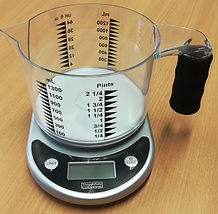 This image shows an RNIB talking kitchen scale with easy to see measuring jug.