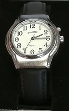 This image shows a talking watch with a leather strap and analog face.