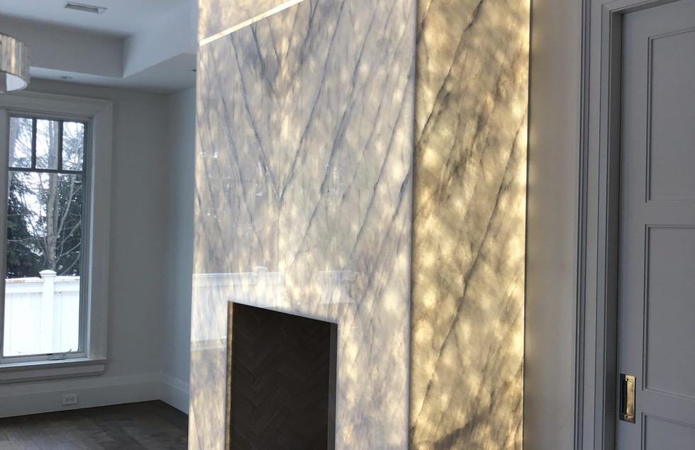 Fireplace featuring Statuario Africano b