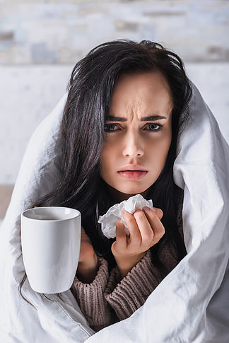 bigstock-Sick-Young-Woman-With-Tissue-A-400472750.jpg