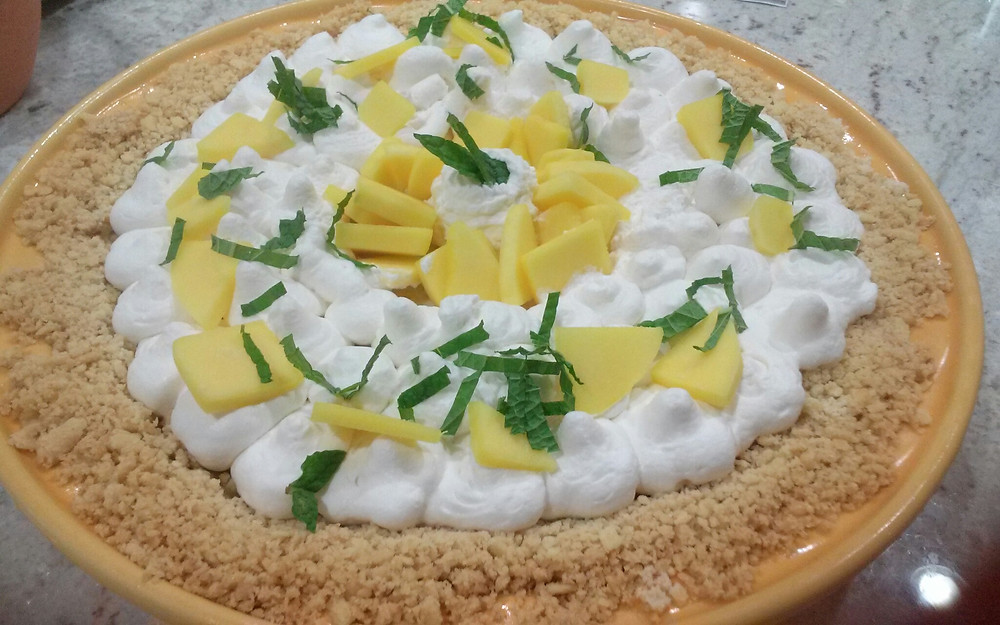 Fresh Mango, Homemade Whipped Cream and Mint topped pie