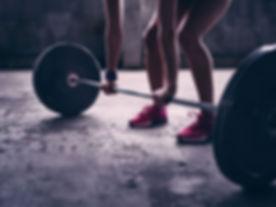 woman-lifting-weights-getty.jpg