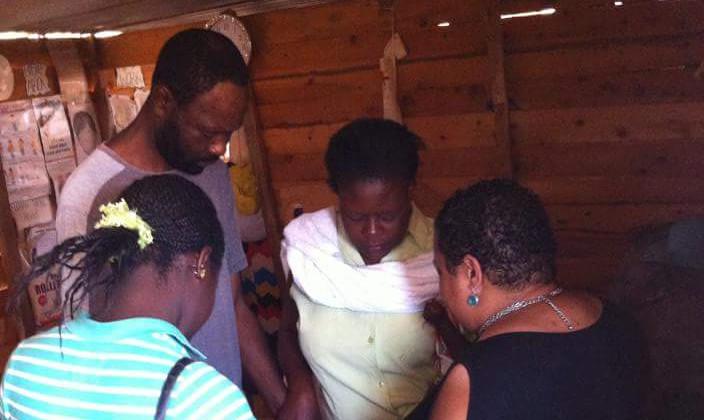 Praying with congregants- Harare, Zimbabwe