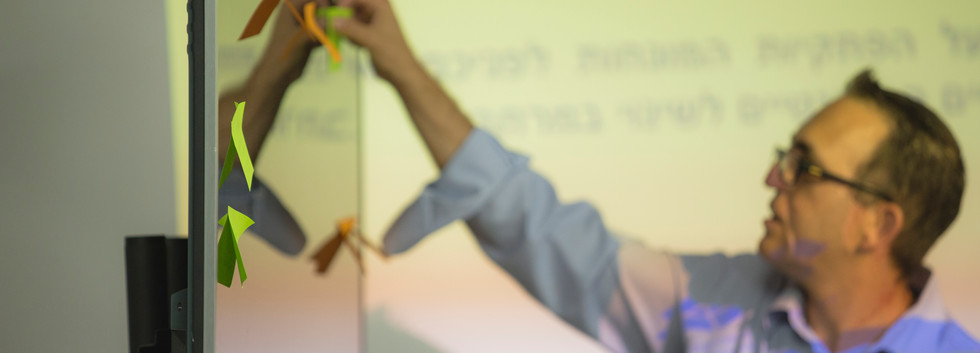 CEO Eran Shayshon leading a breakout group.
