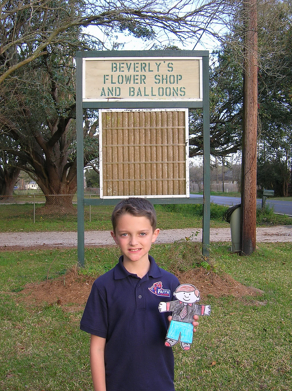 This is my son in 2009 and the only shot I have found of the old flower shop sign!