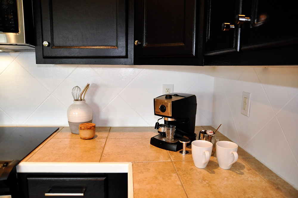 The backsplash tile used to be the same as the counters and floors.