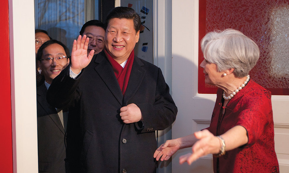 "On February 15, 2012, almost 30 years after his first visit to Iowa, Vice President Xi Jinping walked through the front door of the Lande home in Muscatine, Iowa, for the second time. He smiled and was heard saying, ""it feels like coming home."" Sarah Lande extended a warm Iowa welcome. (Photo courtesy of the Office of the Governor of Iowa)"