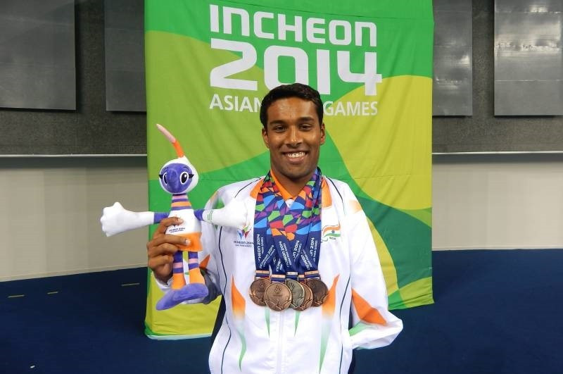 Sharath with five of his six medals from the 2014 Asian Para Games. Photo credit: Sportskeeda