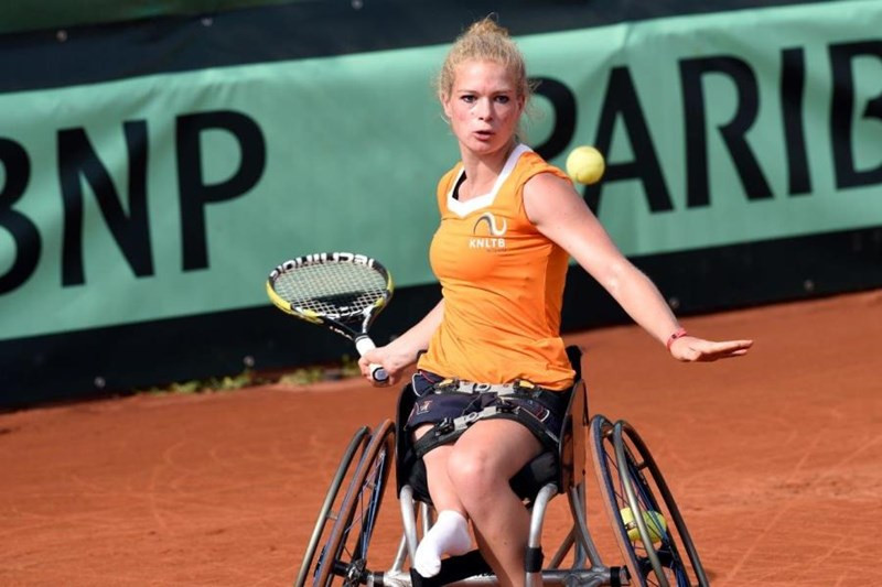 Parasports in Action: Dutch Wheelchair Tennis Player Diede de Groot just before hitting the ball. Stay tuned: Parasports World provides parasports news, paralympic sports entertainment and disability sports community. Find great sports and inspiring athletes. Read about Paralympic Games, the Invictus Games, Special Olympics and all the other parasports championships.