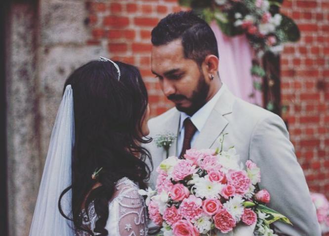 Bridegroom looks at his Bride