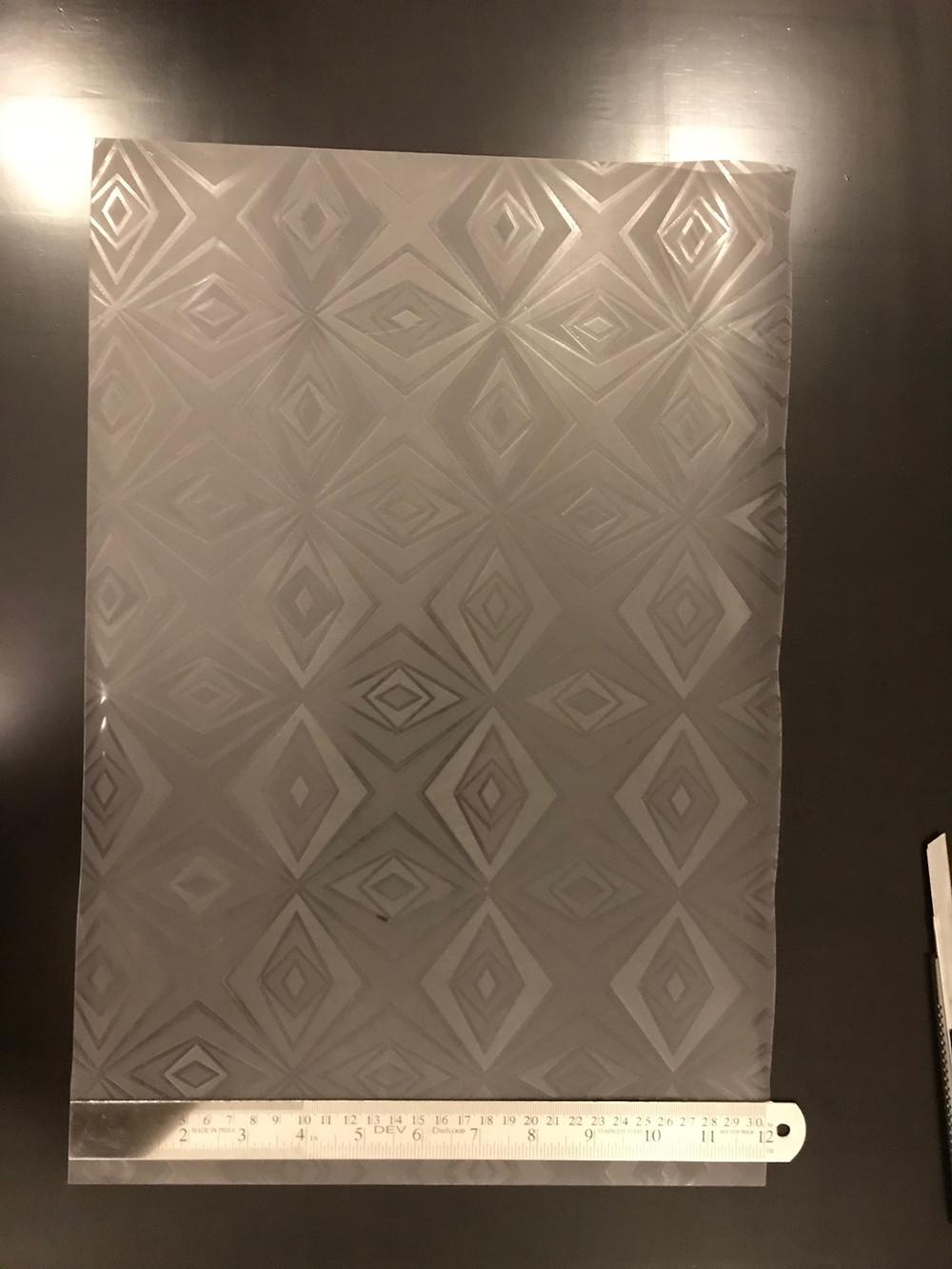 Plastic sheet with metal ruler