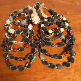 Stacks of velvet seed bracelets.JPG
