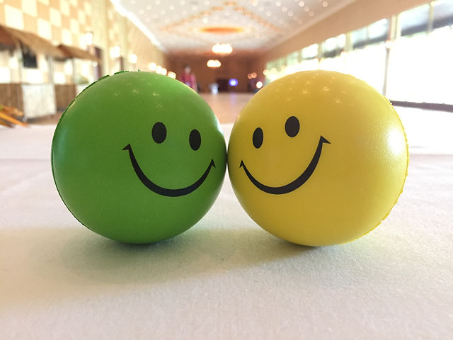 Smiley faces on the yellow and green bal