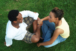 Couple Holding Hands On Grass