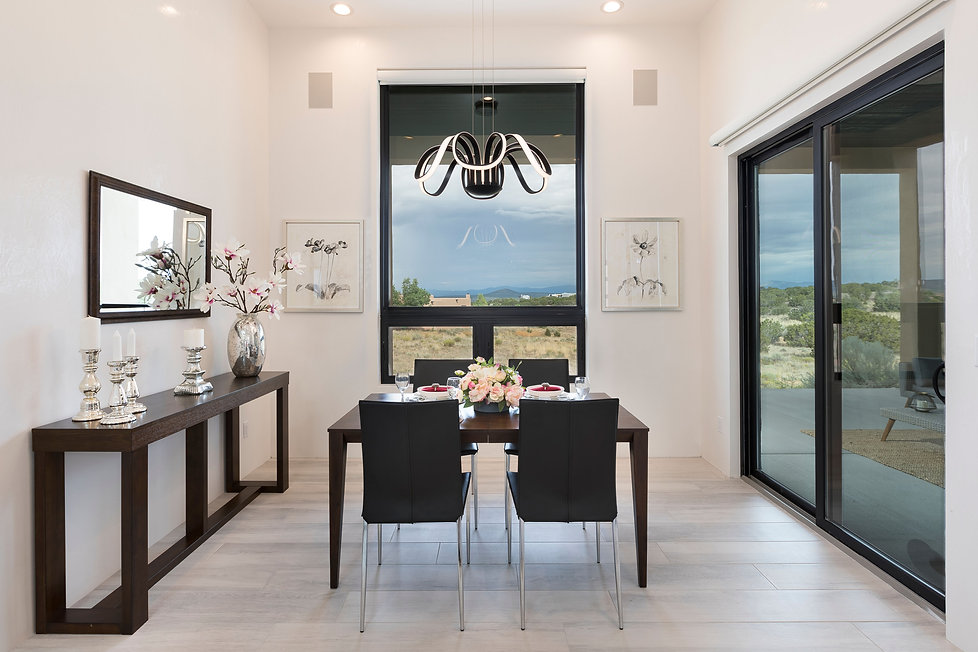 Home styling of a dining room with a clean modernist aesthetic.