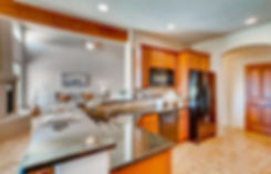 Gleaming kitchen counters and warm wooden cabinets in modern Southwest home.