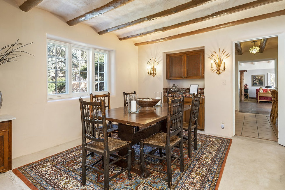 Formal dining area with dramatic vintage fixtures.