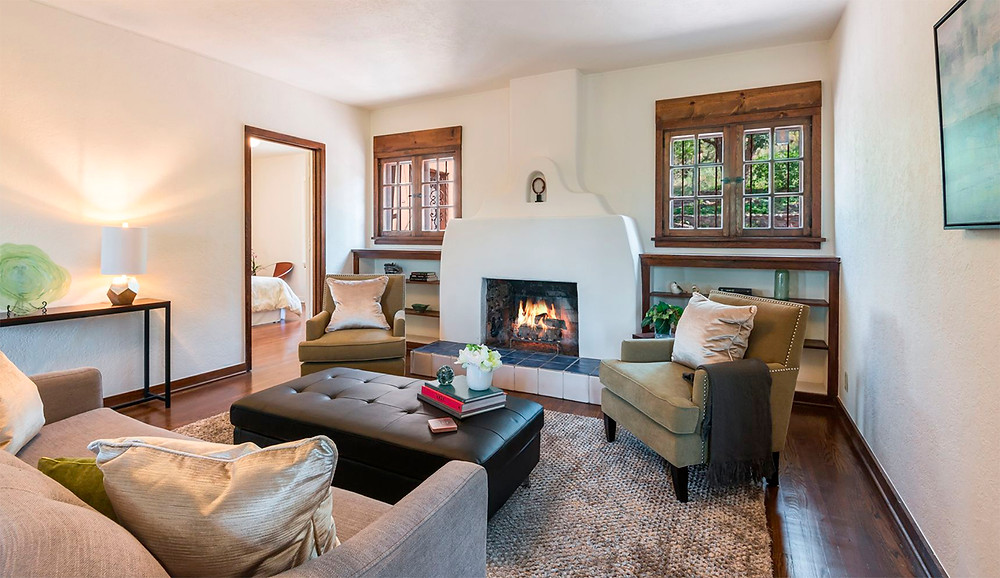 Cozy Santa Fe living room with fireplace professionally staged by DeMarais Home Staging + Deign.