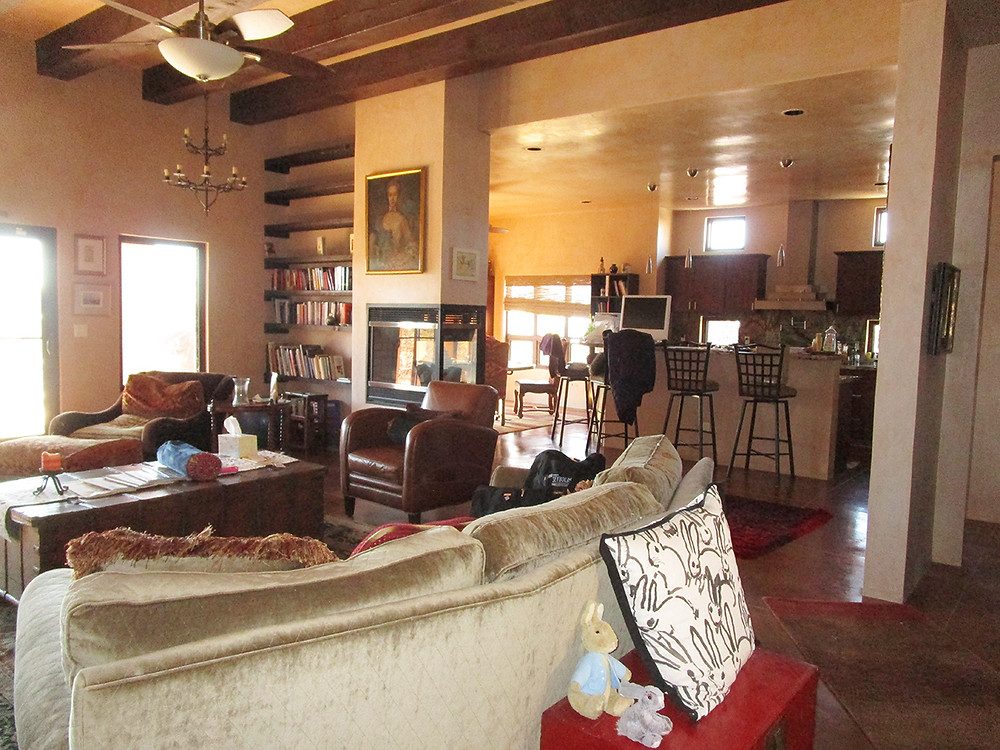 Contemporary pueblo-style living room with owner posessions prior to home staging services.