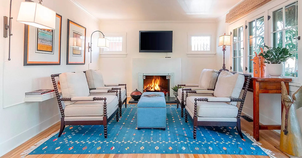 Cozy living room seating in front of fireplace.