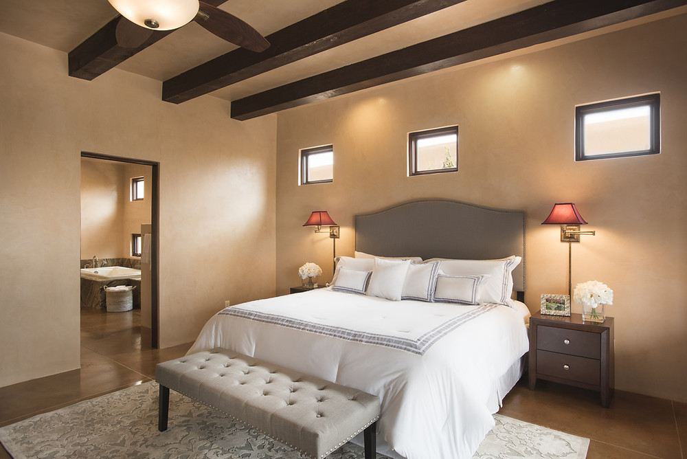 Updated decor in pueblo-style master bedroom suite gives potential buyers appreciation of space.