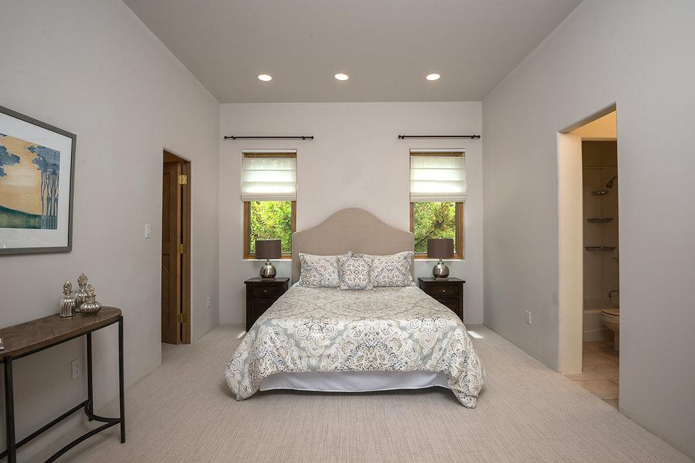Elegant minimal bedroom styling by Santa Fe home stager Debbie DeMarais.