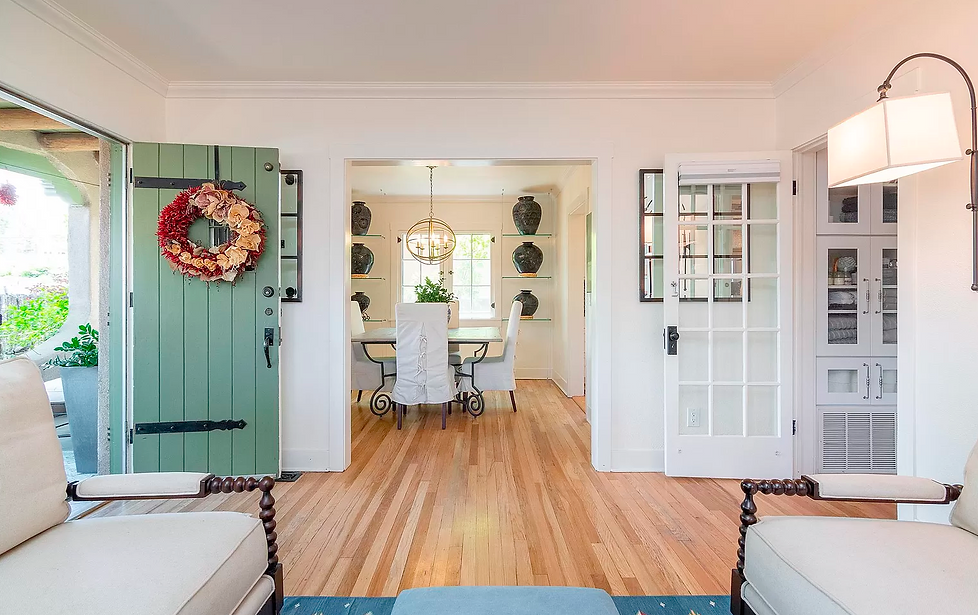 Looking from the living room, past the entry, and into the dining room of this SW style bungalow.
