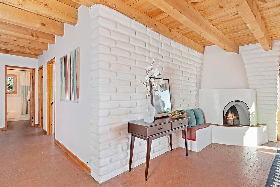 Adobe trombe wall and brick floors act as passive solar elements that hold heat from New Mexico sunshine.