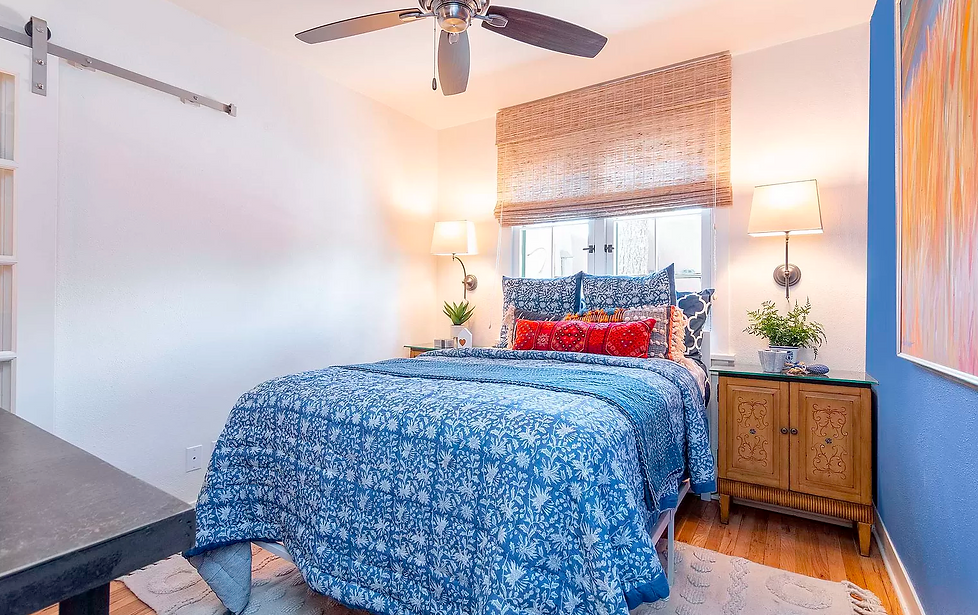 Adorable blue guest room in sweet Santa Fe bungalow.