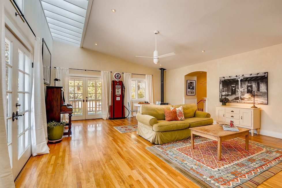 Family room with skylights, wood floors, piano and decorative gas pump!