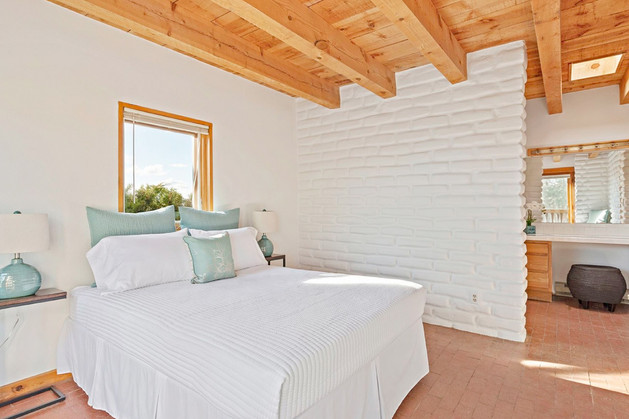Verano Place | Adobe Wall Hides Master Bath