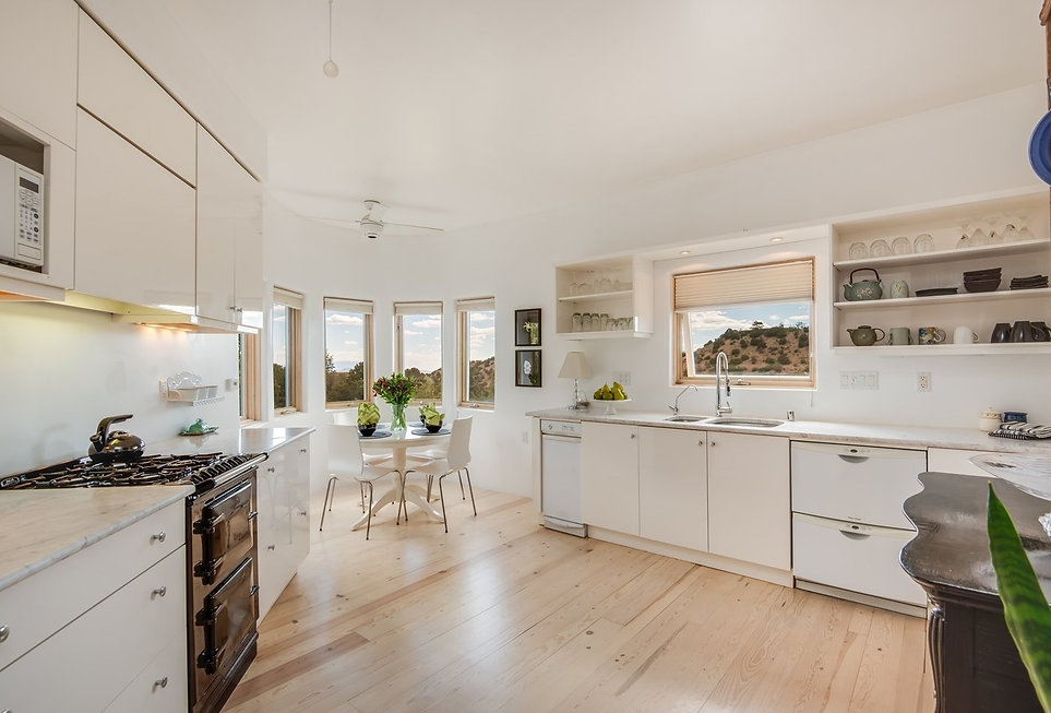 Spacious clean kitchen decluttered and staged for real estate open house.