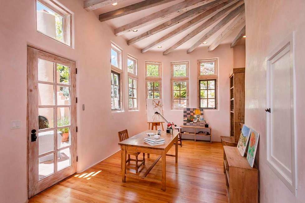 Bright art studio with vaulted ceilings in historic Santa Fe home.