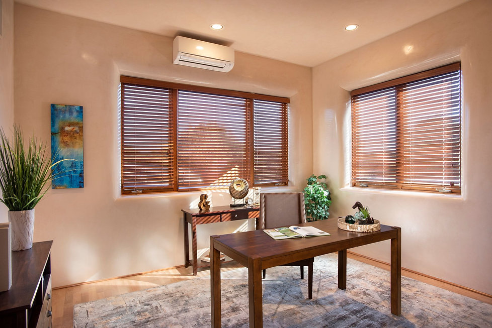 Simple home office with wooden blinds to soften the New Mexico sunshine.