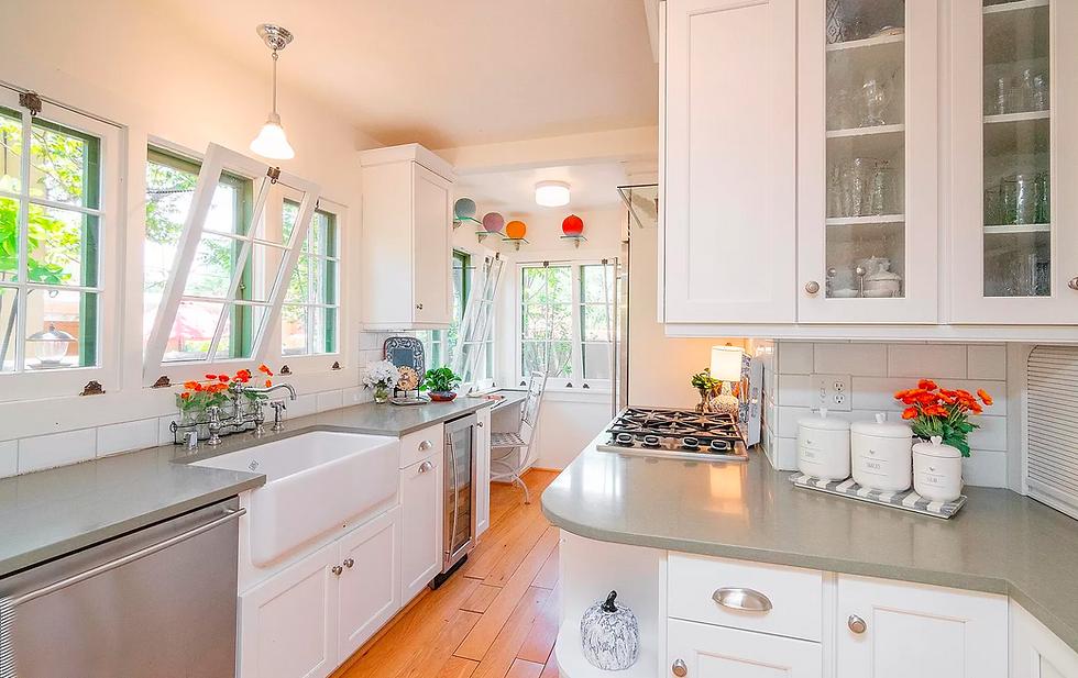Charming kitchen in rare Southwest-style Santa Fe bungalow.