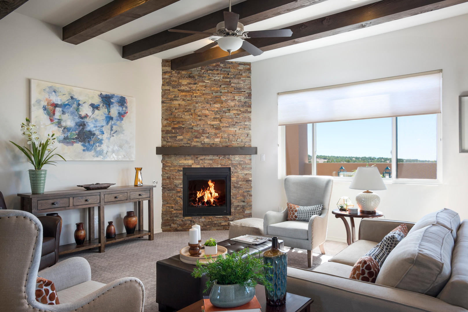 Via Tessera | Living Room Seating and Stone Stack Fireplace