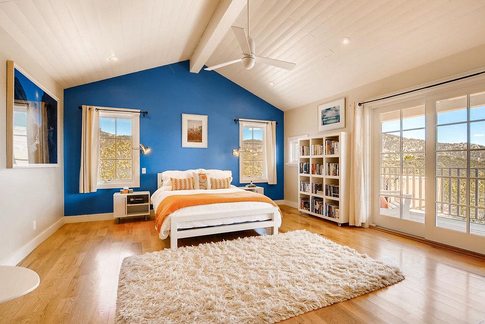 Bedroom in custom Santa Fe home staged using on-site furnishings.