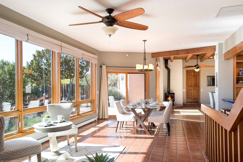 Natural light floods through New Mexico home dining room.
